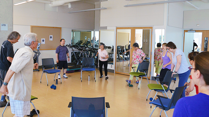 Exercise study participants in a group exercise class.